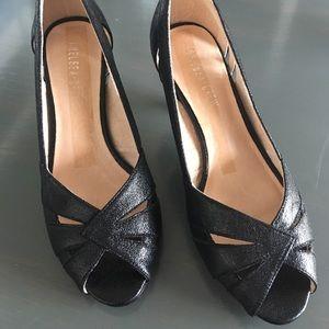 Women's kitten heel, open toe shoe.